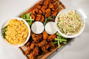 Chicken Wings, Macaroni & Cheese, celery, coleslaw board
