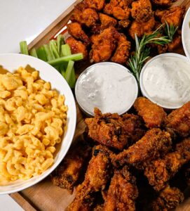 chicken wings party board with macaroni